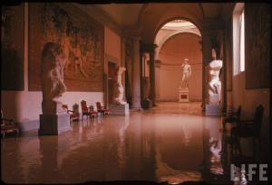 Michelangelo's David (Rear C) and other of his sculptures in gallery of the Accademia in wake of devastating flood.