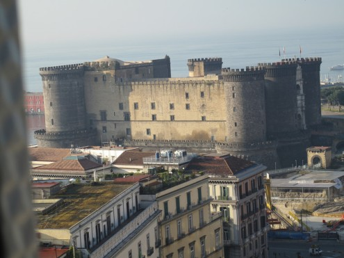 "The Maschio Angioino (Angevin Fortress), more commonly known as the Castel Nuovo. You have to love a place that refers to a castle built in the 13th century as ""new."" This was taken from a 15th floor window of our hotel."