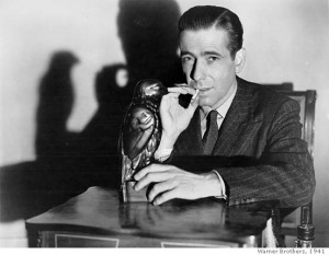Humphrey Bogart, with the objet d'art that caused all the trouble