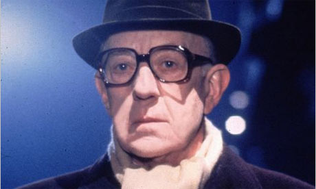 Alec Guinness as George Smiley, whom he portrayed in the tlelvised films of Tinker, Tailor, Soldier, Spy (1979)  and Smiley's People (1982). For many, his is the quintessential depiction.