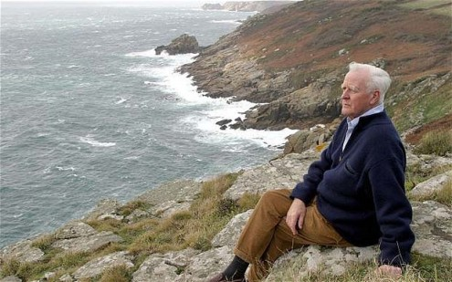 John LeCarre, with suitably brooding mien, at his cliffside retreat in Cornwall.