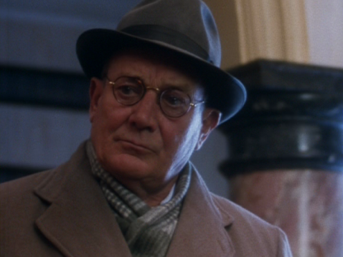 Denholm Elliott as George Smiley in A Murder of Quality, 1991