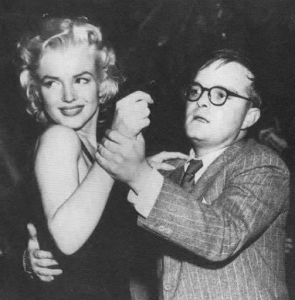 Capote dancing with Marilyn Monroe