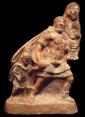 Aeneas escaping Troy, carrying his father Anchises on his back and holding his son's hand. Terra cotta figure found in Pompeii, now in the Naples National Archaeological Museum